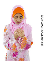 malay muslim girl praying with isolated white background