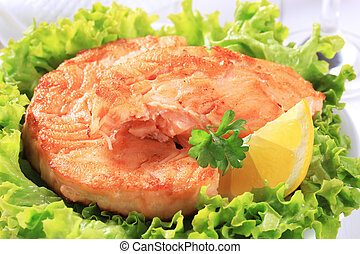 Pan fried salmon patty served on lettuce