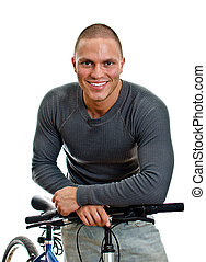 Sporty male with bicycle. Isolated on white.