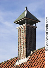 Chimney over a red tiled roof
