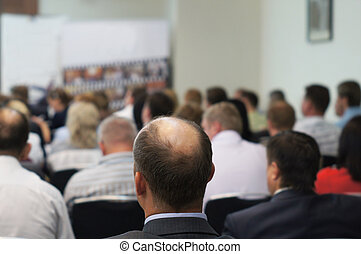 conference hall - The audience listens to the acting in a...