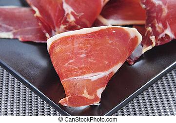 serrano ham tapas - closeup of a some spanish serrano ham...