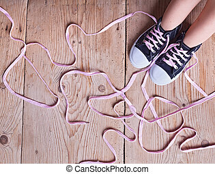 The problem - childs feet and long twisted shoelaces - The...