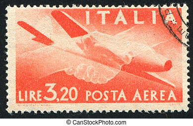 Plane and Clasped Hands - ITALY - CIRCA 1945: stamp printed...