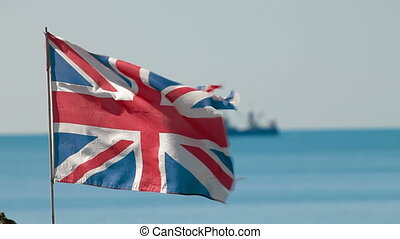 British Flag - The British flag on the background of the sea...