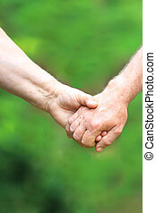 two hands  of the elderly couple
