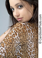 Woman in animal print top - Young woman with dark curly hair...