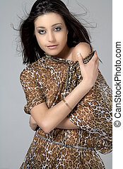 Woman in animal print top - Young woman with long dark hair...