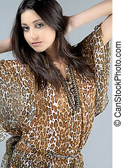 Woman in animal print top - Young woman wearing an animal...