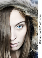 Blueye in hood - Portrait of a beautiful blue eyed young...