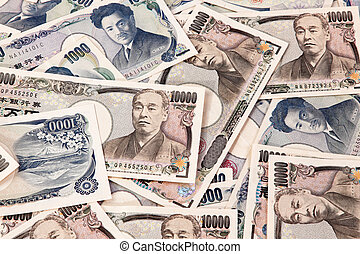 dollar bills, currency from japan - many japanese yen bills...