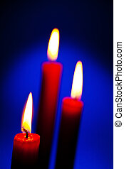 flame of a candle - the flame of a candle brings light into...