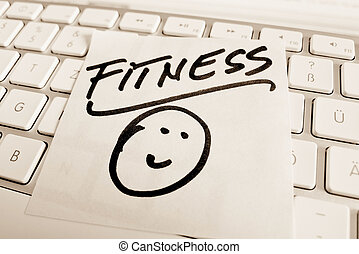 note on computer keyboard: fitness - a memo is on the...