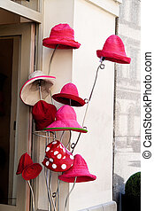 red hats in front of a millinery