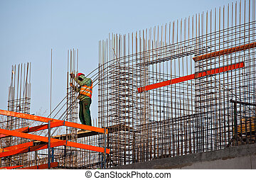 Worker prepearing concrete bars - Worker prepearing steel...