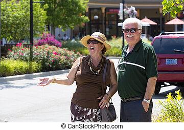 Happy Shoppers - Senior couple cant hide good feelings