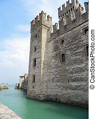 Italian castle - The fortified walls of Sirmione at Lake...