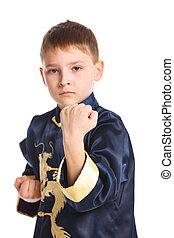 Aikido boy fighting position in black kimono. Focus on the...