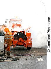 Asphalt patching during road works - Asphalt and concrete...