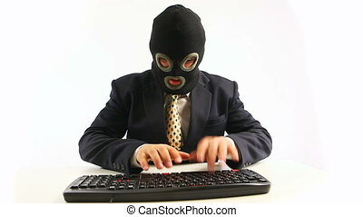 office hacker in anger - guy in official suit and balaclava...