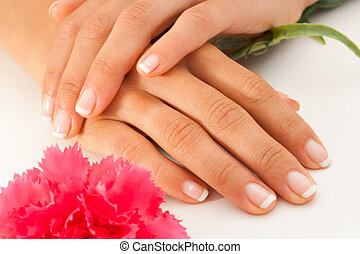 Female hands with french manicure - Extreme close up of...