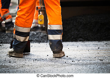 Road construction, new asphalt - Workers on a road...