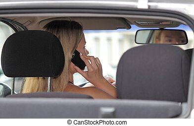 Woman driver talking on her mobile phone