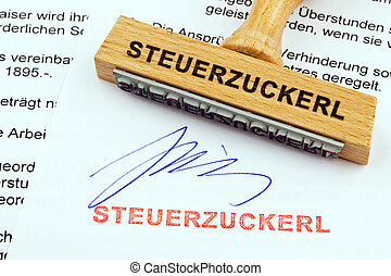 wood stamp on the document: tax treat - a stamp made of wood...