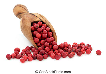Pink Peppercorns - Pink peppercorn spice in an olive wood...