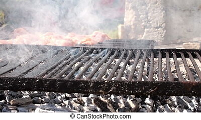 Hot grill with meat - Preparing a very delicious barbecue