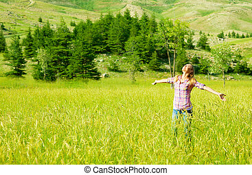 Happy girl enjoying nature, young woman on wheat field,...
