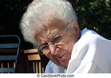 Introspective Senior - Closeup of a senior citizen woman...