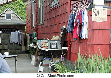 Clothes and Other Items for Sale - Outdoor yard sale of...