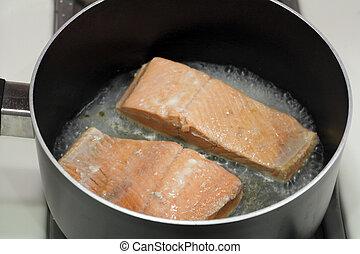 Two Salmon Fillets Poaching - A couple of wild salmon...