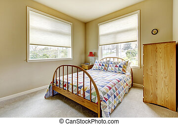SImple guest bedroom with wood old bed.