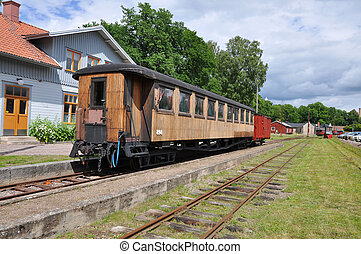 Old train cars - Old passenger train or rail car at station...
