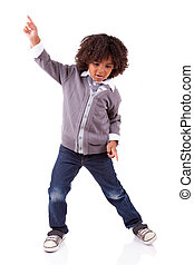 Little african american boy dancing,isolated on white...
