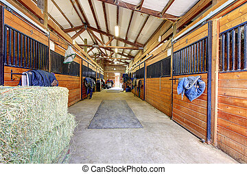 Horse stable interior with hey and wood doors. - Nice large...