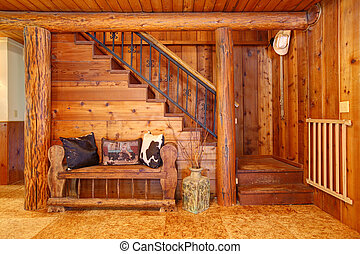 Rustic log cabin stairace and bench details.