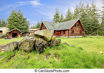 Classic old log cabin house in the country side.