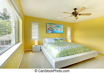 Yellow modern bedroom with white bed.