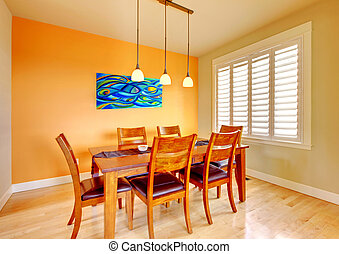 Dining room with blue painting and wood table - Orange...