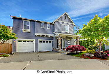 Grey American house with two garage doors. - Grey classic...