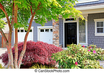 Grey house exterior front door and two garages. - Beautiful...