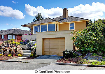 Modern caramel color house with garage. - Modern house with...