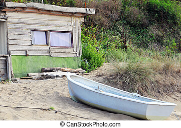 an old shack by the sea and theboat - an old shack by the...