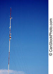 antenna tower soaring into the blue sky