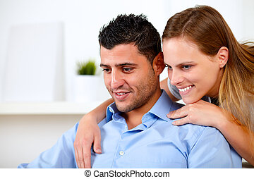 Beautiful couple in love looking something - Portrait of a...