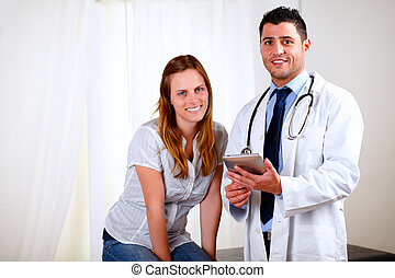 Young pretty woman with her medical doctor