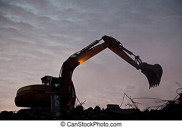 Demolition - Excavator demolishing building